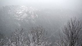 Snow over the ancient village of Sacred Mount of Varese stock video footage