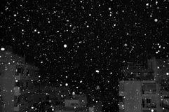 Snow over city buildings Stock Photos