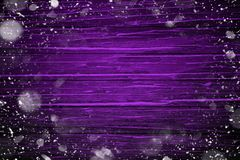 First snow frame on violet wooden table background for Merry Christmas and Happy New Year . royalty free illustration