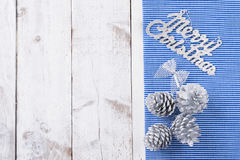 Snow painted pine cones on rustic white wood table. Christmas decoration background Royalty Free Stock Photo