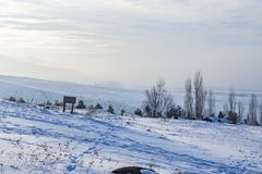 Snow with paladoken mountains background in mist in Erzurum, Turkey. With mist royalty free stock images