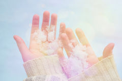 Snow on palms of a girl Stock Images