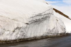 Snow parapet along road on Cross Pass of Georgian Military Highway in late spring. Caucasian ridge stock photo