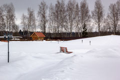 Snow park with benches and lanterns Royalty Free Stock Photography