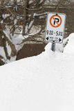 Snow Parking. MARCH 9 2008: Snow drifts as high as the streetside parking signs after a heavy snow storm in Ottawa Ontario Canada Stock Image