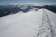 Snow path. In high mountains stock images