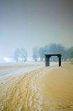 Snow path leading to the wooden structure Royalty Free Stock Image