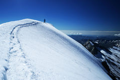Snow path. And a man on a horizon on a mountain top Royalty Free Stock Photo
