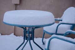 Snow on the patio table. Stock Photography