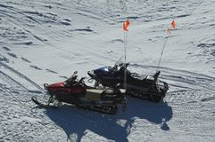 Snow patrol ski mobiles. Stock Photography