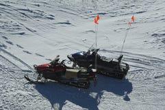 Snow patrol ski mobiles. stock photography