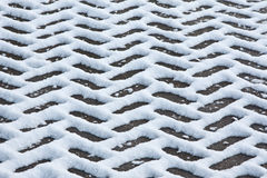 Snow Pattern. Melting snow on a herringbone paved driveway Royalty Free Stock Photos