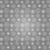 Snow pattern. Seamless pattern of white snowflakes on a gray background Royalty Free Stock Photography