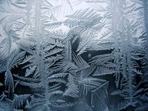 Snow pattern on winter window Stock Photo