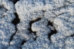 Snow patterns on the ground stock photos
