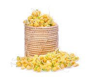 Snow pea sprouts in wooden basket isolated on white. Background Stock Photos