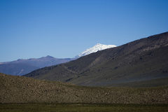 Snow peak of Ampato volcano in Peru. Snow peak of Ampato volcano viewed from behind the closest hills Stock Photos