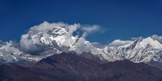 Snow Peak of Dhaulagiri Mountain in the Himalayas in Nepal. View from Poon Hill.  royalty free stock images