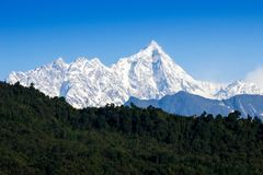 Snow at the peak of mountain with blue sky at Sikkim Royalty Free Stock Images