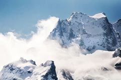 Snow at the peak of mountain with blue sky at Sikkim Stock Images
