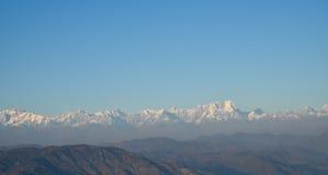 Snow peaked himalayan ranges with blue sky Stock Photos