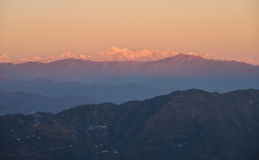 Snow peaked himalayas during sunset Royalty Free Stock Photography