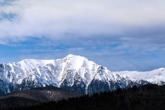Snow peaks in the cloudy day Royalty Free Stock Images