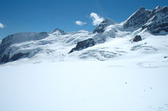 Snow and peaks nearby Jungfraujoch in Switzerland Royalty Free Stock Image