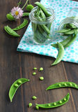 Snow peas pods in jar Royalty Free Stock Image