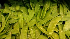 Snow peas at a produce stand. Royalty Free Stock Photos