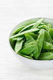 Snow peas in white bowl Stock Images