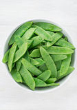 Snow peas in white bowl Royalty Free Stock Image