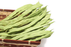 Snow peas in wicker basket Stock Image