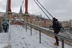 Snow on Pedestrian bridge at Saint-Georges. LYON, FRANCE, March 1, 2018 : Pedestrian bridge over Saone river, as a cold spell rages in all Europe and the Capital Royalty Free Stock Photo
