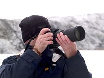 Snow photographer. A photographer at a snow field Royalty Free Stock Photo