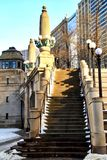 Snow piles on stairway alongside river bridgehouse in downtown Chicago Loop Stock Images