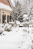 Snow piling out outside home Stock Photos