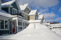 Snow Pillled High Along a Street. Snow is pilled high in front of town houses after a big snow storm Royalty Free Stock Photo
