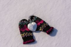 Warm gloves and frosty heart. Snow pink warm  frosty day heart gloves winter clothes symbol gift beautiful romantic love field cold Royalty Free Stock Images