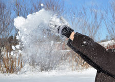 Human Hands Throwing Snow in the Air stock photography