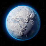 Snow Planet Earth. Winter planet Earth - covered in snow and ice planet with a real detailed terrain, soft shadows and volumetric clouds in space against a Stock Photography