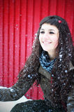 Snow play. Young woman playing in the snow Royalty Free Stock Photo