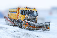 Snow plough in bad weather. The snowplow is ready to remove snow from norvegian winter roads stock photography