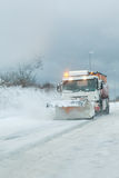 Snow plough clearing heavy snowfall Royalty Free Stock Images