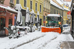 Snow plough clearing snow Stock Photos