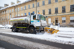 Snow Plough Clears Street in Bath, UK Stock Photo