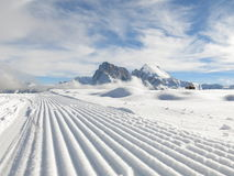 Snow plough in Dolomites Stock Image