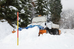 Snow plough making its way through the snow Stock Image