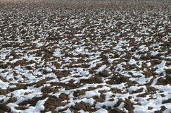 Snow on a ploughed field Stock Images