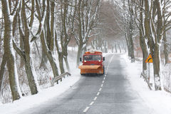 Snow Plow. Removing snow from a road Royalty Free Stock Image